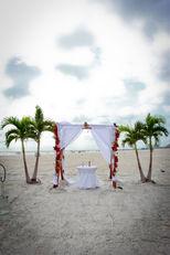 beach ceremony set up grand plaza weddings