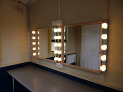 Two Mirror Positions with a Holding Area