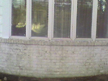 Big Apple Restoration Painte Brick before Sandblast