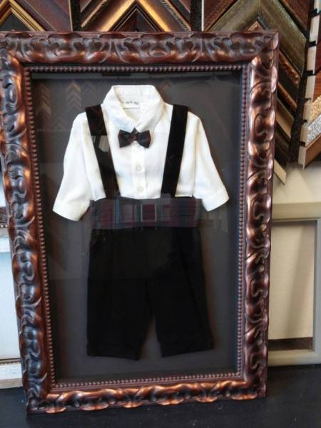 shadow box of boy suit