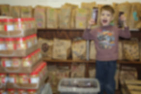 boy holding candy bar