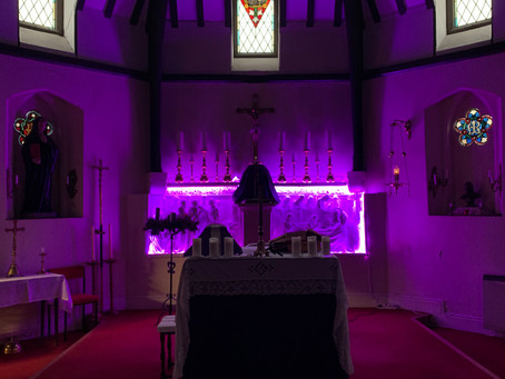 THE CHURCH IN SILENCE WITH A PURPLE GLOW READY FOR THE ASH WEDNESDAY'S MASSES  17TH. FEBRUARY