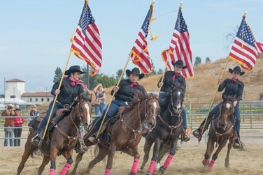 The drill team (from left) Alexis Kiefer, Ana Quintanilla, Alyssa Larson and Sabrina Galasso, perform for the 8th Annual Parade of Breeds for Veterans Day, held at the Pierce College Equestrian Center in Woodland Hills, Calif. On Nov. 11, 2017. Photo: Samantha Bravo