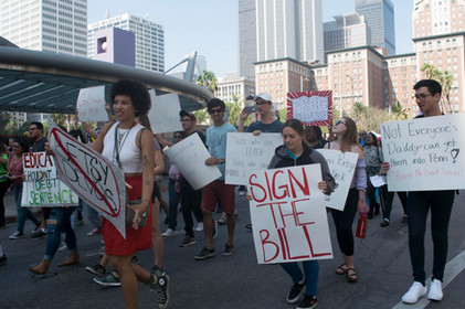 Participants as well as Pierce College students, hold posters at Pershing Square for the Students March on Saturday, September 30, 2017 in Downtown Los Angeles, Calif. Photo by Samantha Bravo