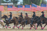 The drill team performs for the 8th Annual Parade of Breeds for Veterans Day, held at the Pierce College Equestrian Center in Woodland Hills, Calif. On Nov. 11, 2017. Photo: Samantha Bravo