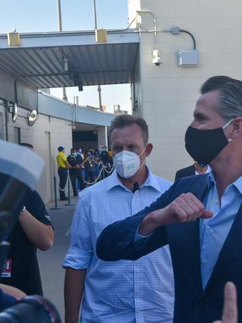 Governor Gavin Newsom talks to voters at the Dodger Stadium.