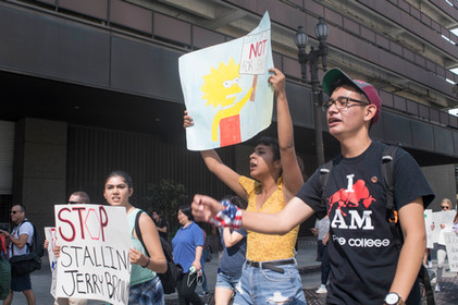 Pierce College student and chair community welfare committee Gisela Tarifa (left) and Associated Students Organization President Efren Lopez (right) march with the crowd to City Hall at Los Angeles on Saturday, September 30, 2017 in Downtown Los Angeles, Calif. Photo by Samantha Bravo
