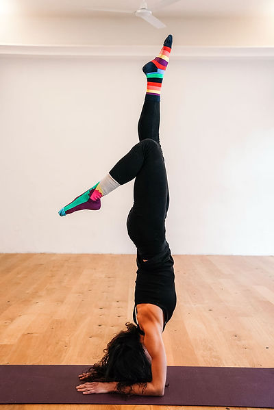 Betti_doing_Pincha_yoga_pose.jpg