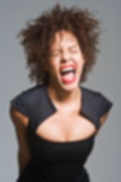 A black woman shouting in frustration