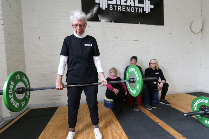 The average age of a group of powerlifters in Castlemaine is 75 years old.