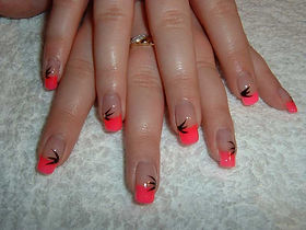 Nail extensions with pink tips and black flicks