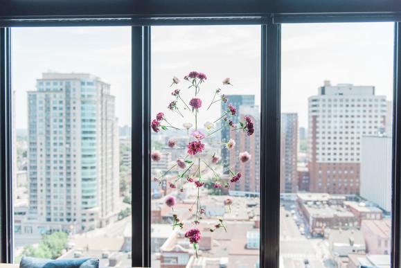 Floral petal mosaic on window