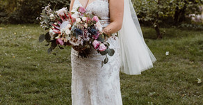 Waterfront navy and coral wedding with a boho beach twist