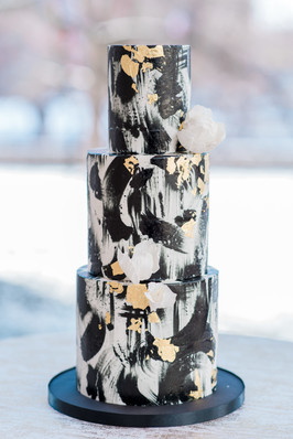 Black and gold brush stroke wedding cake