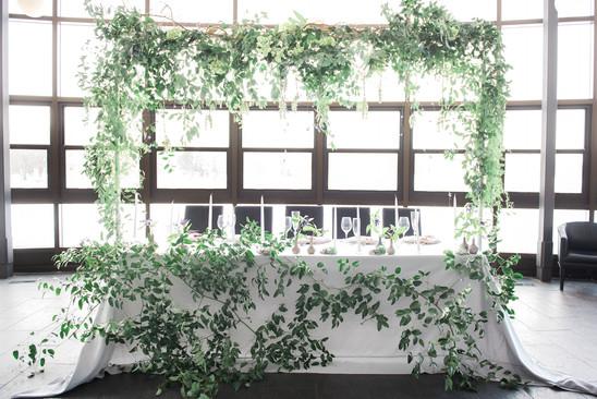 modern head table in greenery garland iv