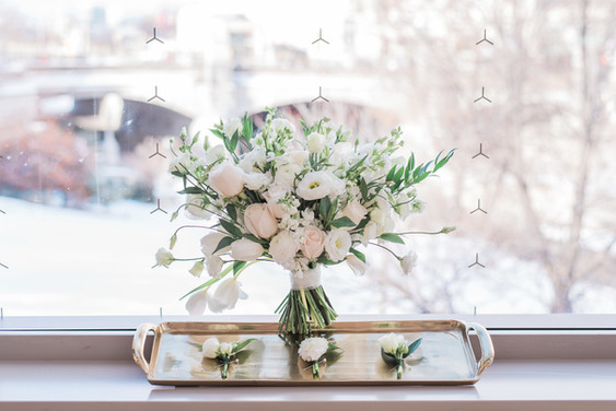 All white spring wedding bouquet and boutonnieres