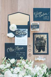 Elegant black and gold wedding stationery