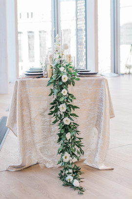 organic garland and white bloom table runner