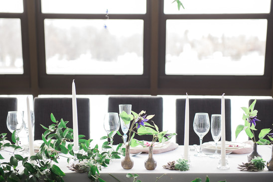 Modern tablescape design with greenery