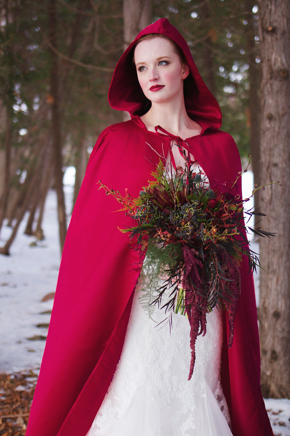 Bride with red bloack and bouquet