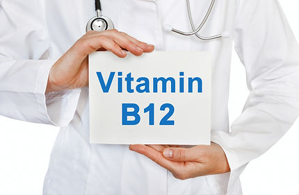 Doctor holding a card with Vitamin B12,