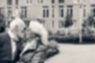 Black and white photo. Elderly man kisses an elderly lady. Concept_ family, love, date. Fancy clothe