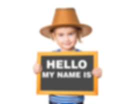 "Naming Ceremony Image - young girl holding sign ""My Name Is.."""