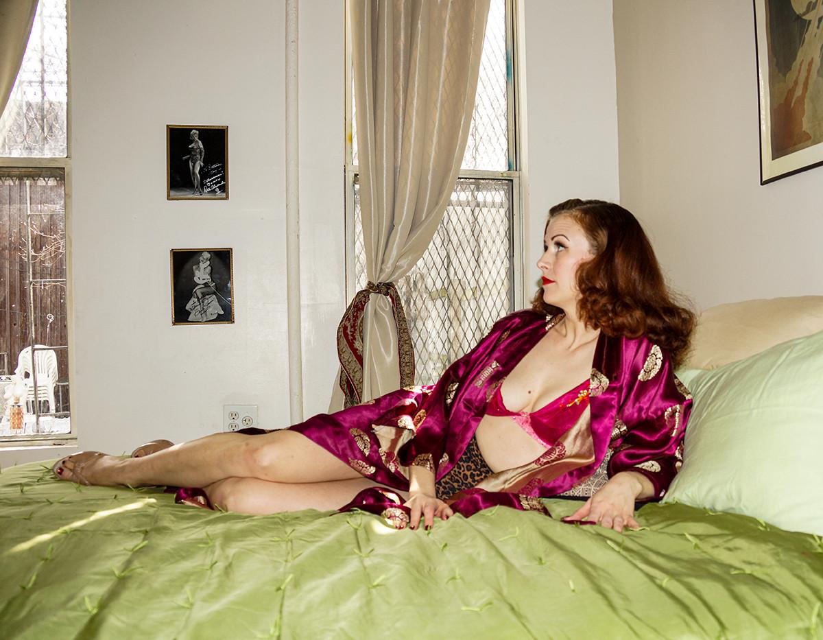 Burlesque star Bettina May posing in her