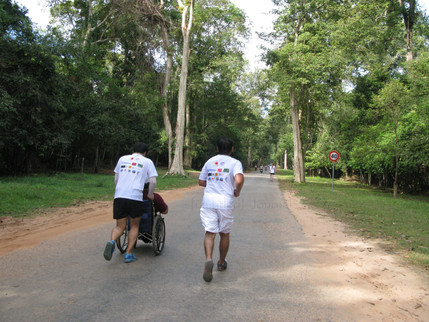 Running with the disabled (Angkor Wat Half Marathon)