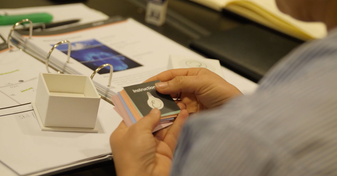 Photo of hands holding an instruction card