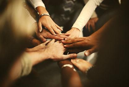 people-stacking-hands-as-team.jpg