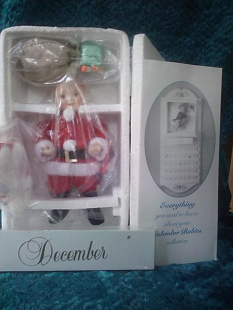 Baby Santa Claus - Calendar Dolls Collection