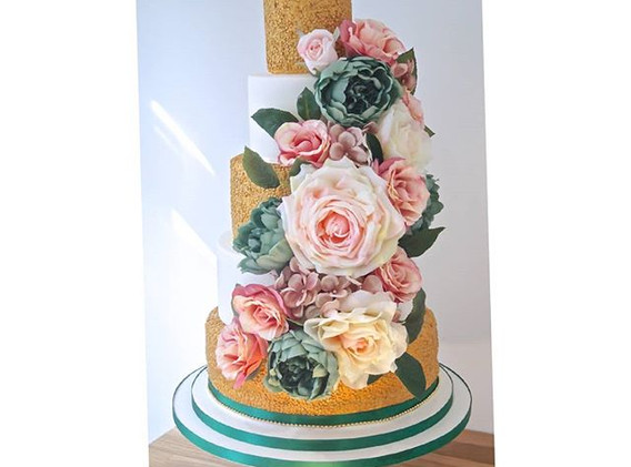 Gold sequinned and floral cake