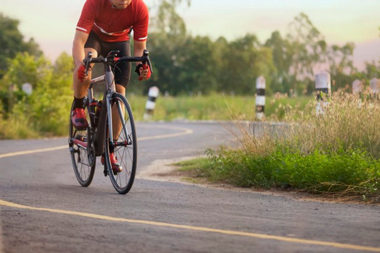 cyclist-in-a-road-outdoors-at-sunset-tim
