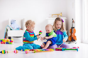 Children with music instruments. Musical education for kids. Colorful wooden art toys. Little girl a
