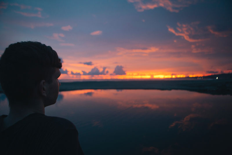 Photo: a person looks out to the horizon