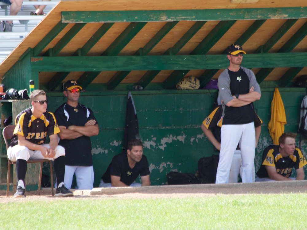Tanner Spencer, right, looks on from the Moose Jaw Miller Express' dugout during action in 2018. (Photo: Marc Smith)