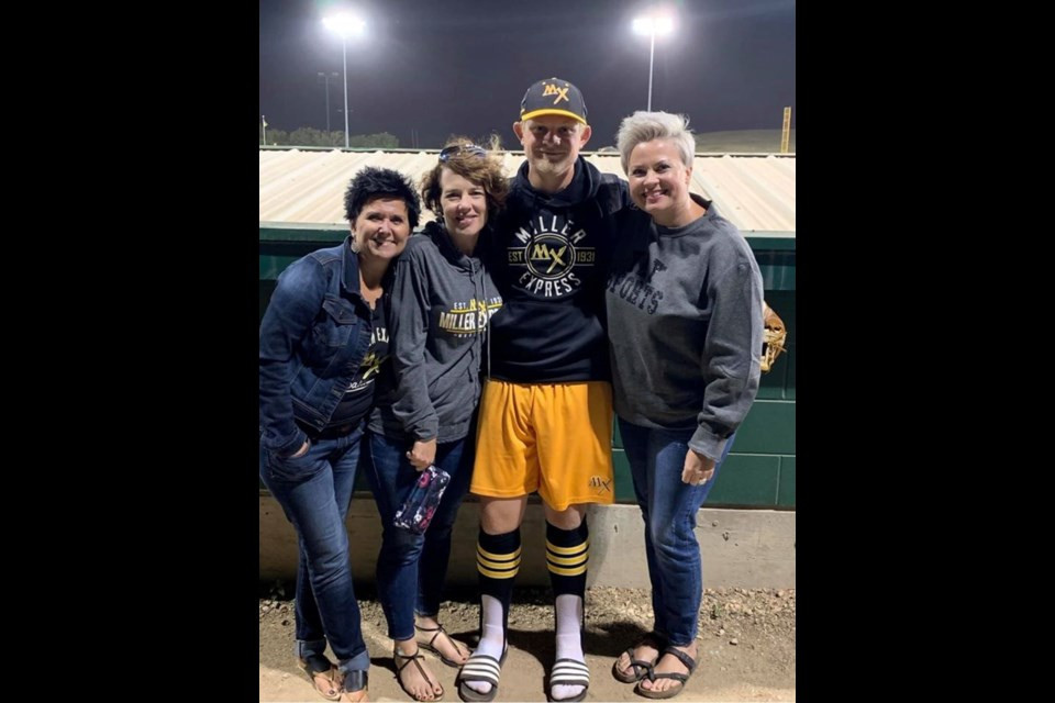 Reece Helland with family members after a Miller Express game last season. (Facebook photo).