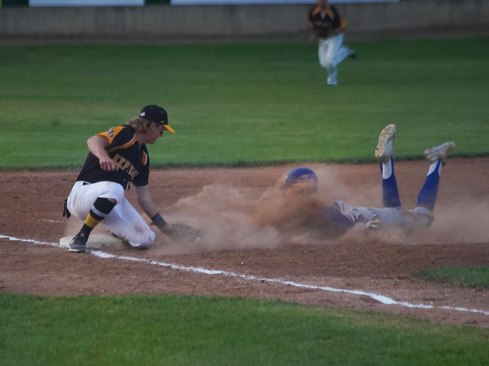 Geordie McDougall tags out a runner at third base during the Moose Jaw Miller Express' 6-5 season opening win over the Melville Millionaires at Ross Wells Park. (Photo: Marc Smith)