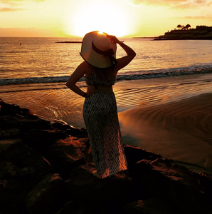 Girl on the beach looking at sunset