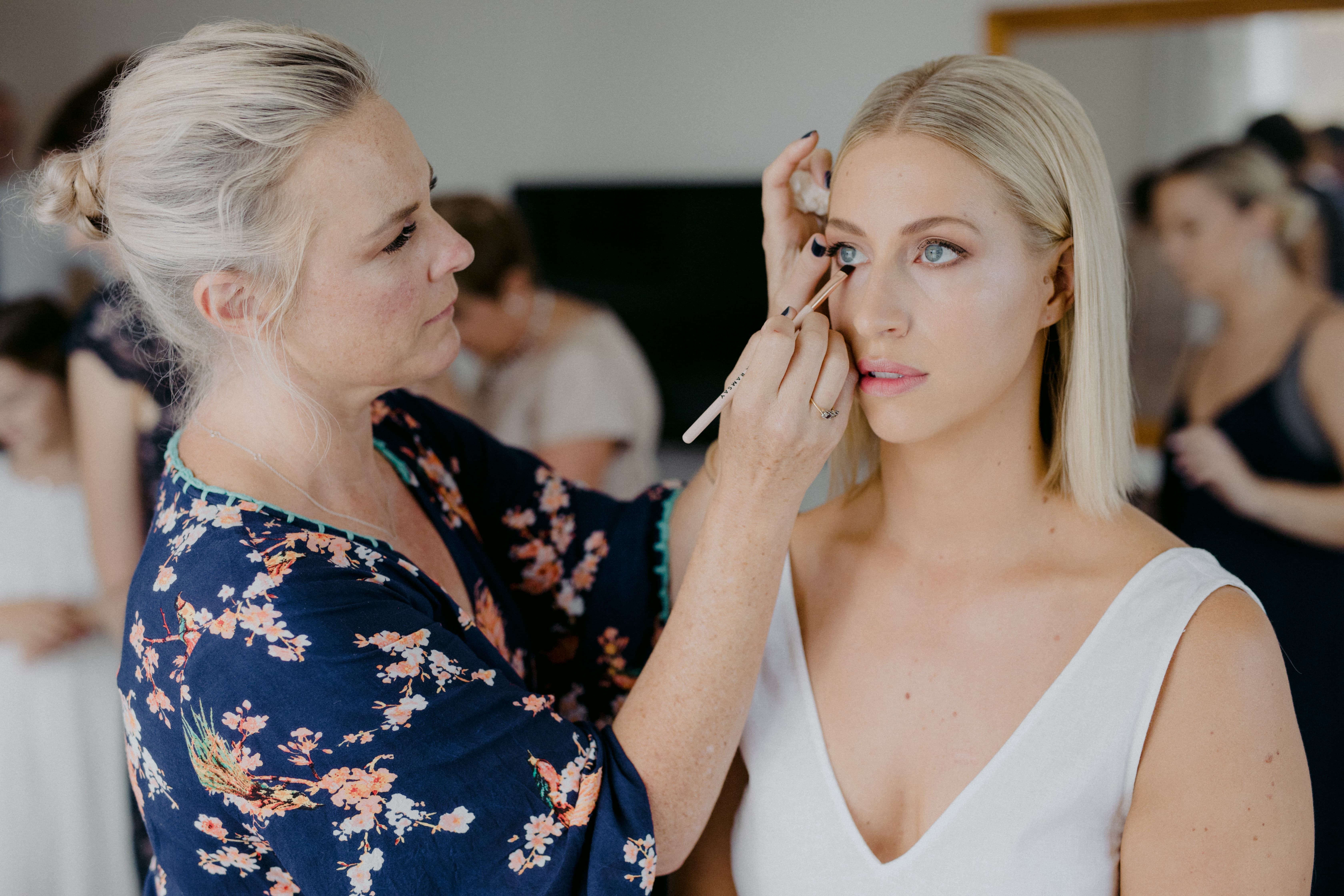 makeup application on bridesmaid