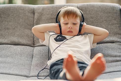 small-kid-listening-to-music-via-headpho