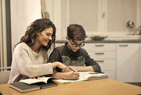 elder-sister-and-brother-studying-at-hom