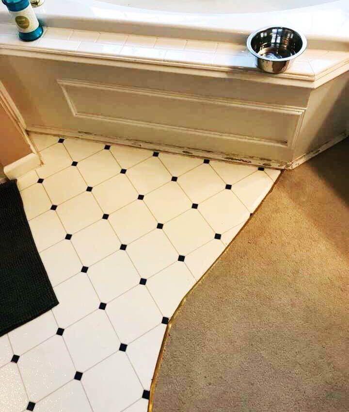 Two existing flooring and tub.