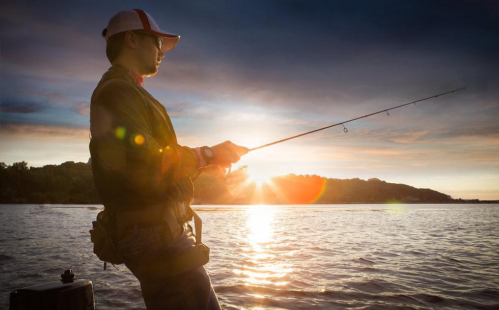 man fishing on a lake_