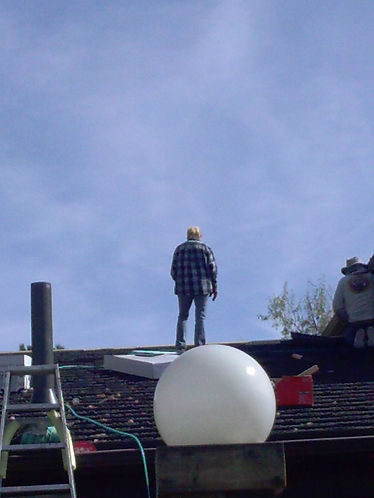 workers on the roof