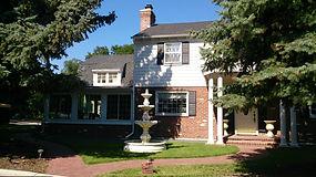 2 story house roof asphalt shingles  with brick chimney