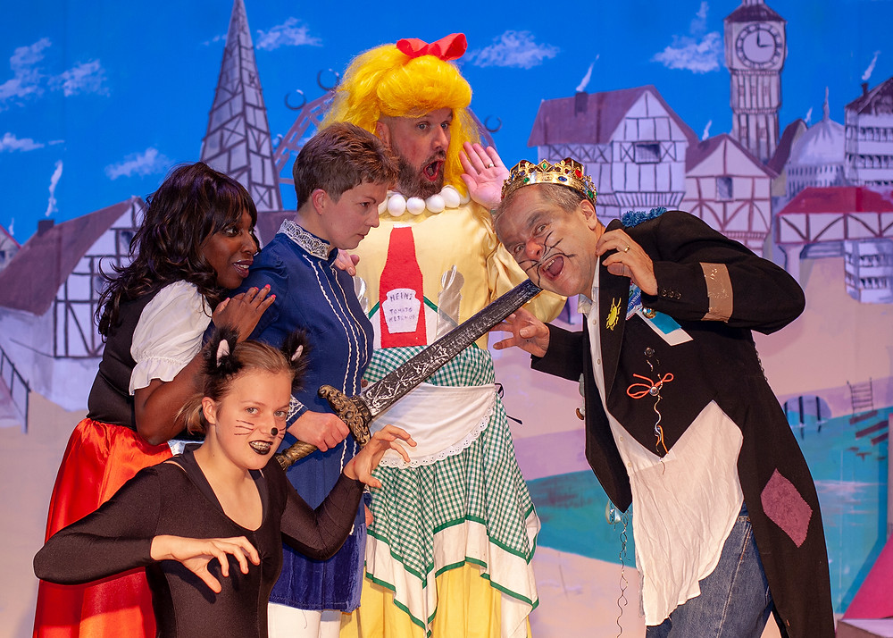 Members of the Downsview Players during the final dress rehearsal of their pantomime, Dick Whittington. The cast (from left to right) include Samantha Canning (Alice), 14-year-old Laura (Tommy the Cat), Julie Nye (Dick Whittington), Steve Canning (Dame) and Simon Charles (King Rat).