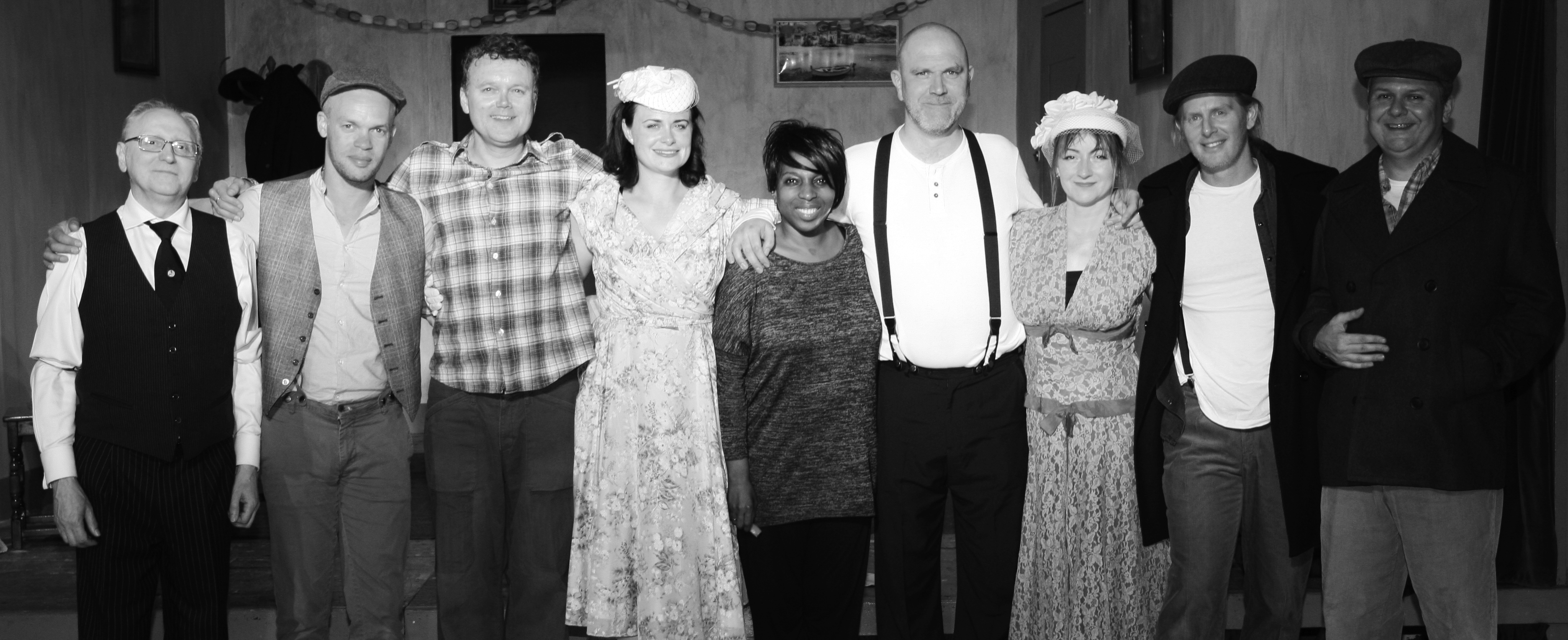 The cast and director (centre)