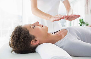 woman-having-a-reiki-treatment-opti-3781